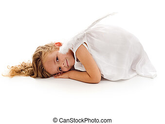 Little girl with angel wings and white dress