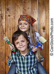 Kids ready to repaint wooden wall