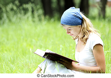 young girl reads the Bible