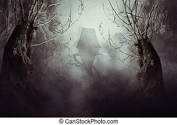 Spooky Witch House in Mist - Halloween night background with...