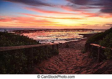 Sandy path to the beach at dawn sunrise
