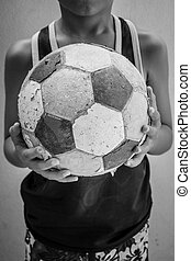 Children hold the old football with filter effect retro...