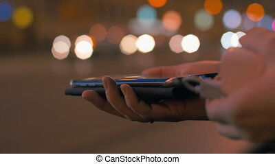 Woman charging smart phone with power bank - Close-up shot...