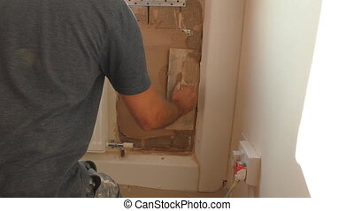 Plasterer apply undercoat plaster - Plasterer applying...