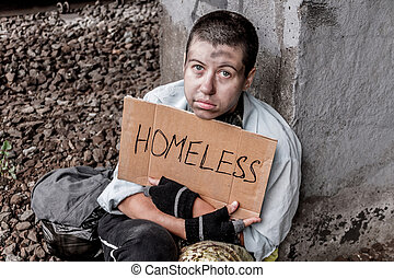 Homeless poor woman with sign