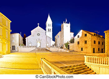 Church and stone squate in Supetar evening view, island of...