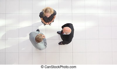 businessteam perspective from top - topview of three...