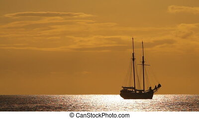 old sailing vessel in sunset