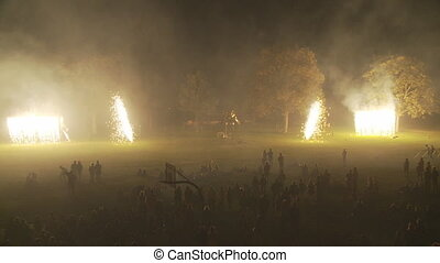 ground fireworks people - fireworks on ground with...