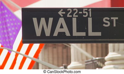 road sign of wall street - close up of wall street sign in...