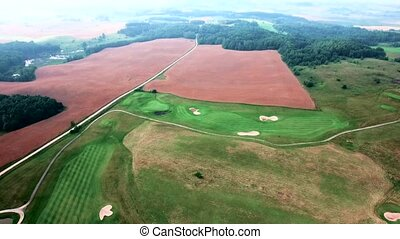 aerial view of golf fields - aerial view of green golf...