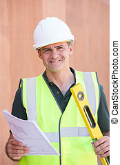 Portrait Of Construction Worker On Building Site With House Plans