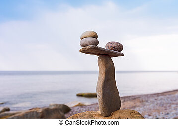 Stones in balance on coast - Balancing of pebbles on the...