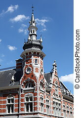 Town house in Leuven with blue sky
