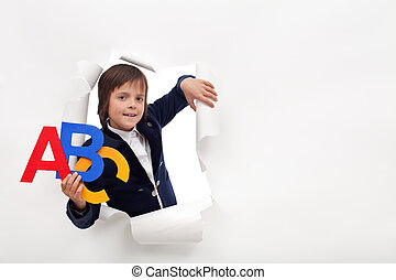 Time to learn - young school boy with colorful alphabet letters
