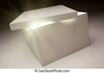 White Box with Lid Revealing Something Very Bright on a Grey...