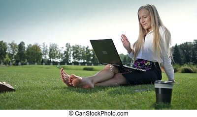 Young businesswoman chatting online using laptop