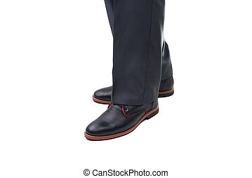 man in fashionable shoes on a white background