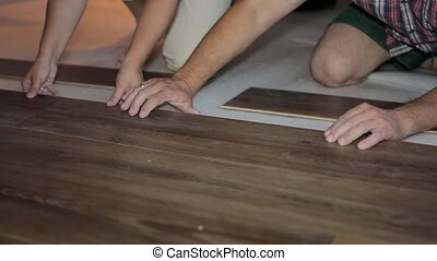 Worker puts the board flooring