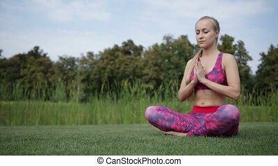 Woman making yoga meditation in lotus posture