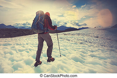 Kennicott glacier - Man hiking with crampins across the...