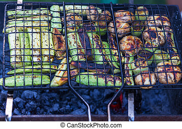 Barbecue - Clos-up shot of barbecue, cooked outdoors on the...