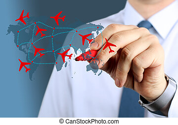 Young business man touching an airplane routes on world map...