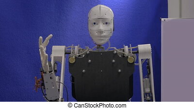Robot greeting with waving hand