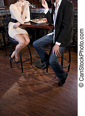 Couple eating sushi in Japanese restaurant - Cropped view of...