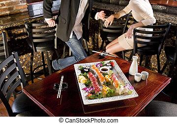 Platter of sushi on table in Japanese restaurant