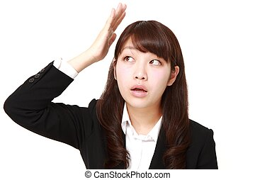 young Japanese businesswoman has lost her memory - concept...