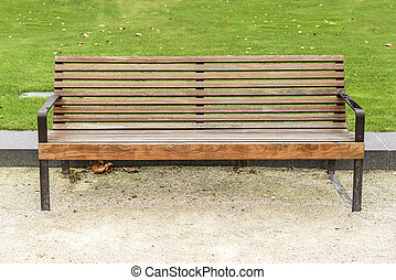 Bench in the city. - Wooden bench in summer park of the...