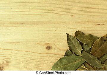Bay leaf - Spice bay leaf on a wooden base.