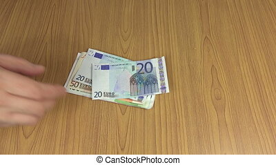 Household man count euro cash money banknotes on table. 4K -...