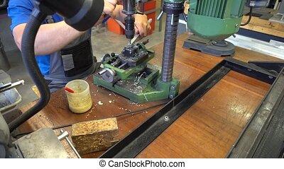 mechanism in metal workshop - worker and mechanism in metal...