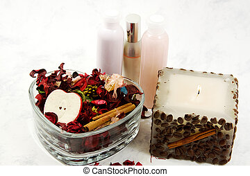 Spa detente - Close up on a candle, lotions and potpourri -...