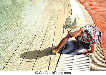child playing near the swimming pool