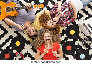 Relax with creative friends - Top view of happy friends with...