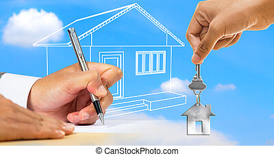 Businessman signing document with house key
