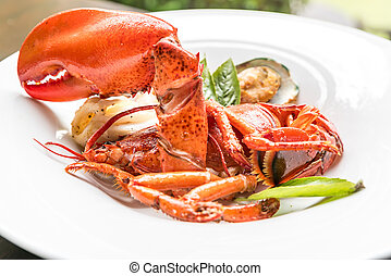 Grilled Halved Lobster Tails with mussel and calamari