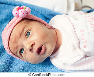 Portrait of a newborn Baby Girl with blue eyes