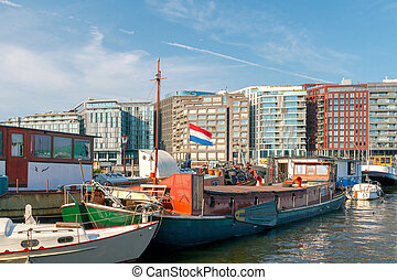 Amsterdam. Amstel River. - View of the River Amstel, houses...