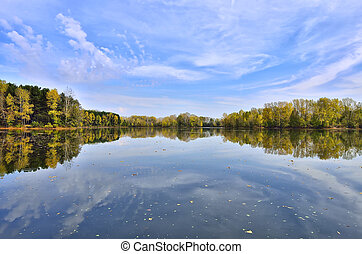 Colorful autumn landscape on the lakeside with reflection of...