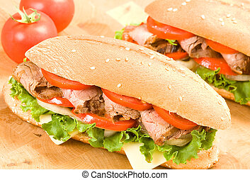 Steak Sandwich - Sliced steak on submarine roll with...