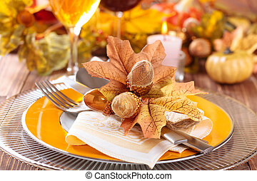 Thanksgiving dinner decoration. - Autumn place setting with...