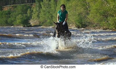 Pretty girl riding horse in the river. Galloping - Pretty...