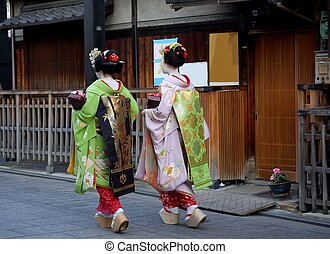 Maiko in Kyoto Japan - Two maikos in traditional kimono...