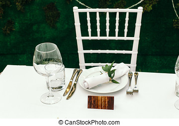 The decor at the wedding Table for guests on the veranda, in...