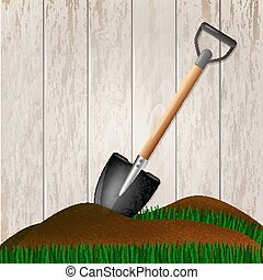 Shovel in the ground. Gardening tool on wooden fence...
