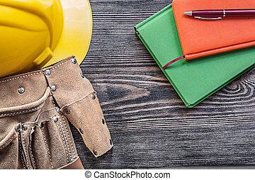 Collection of tool belt notepads pen building helmet